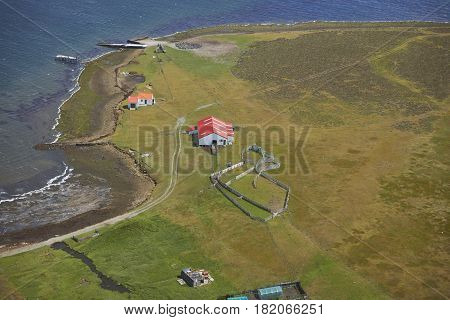 STANLEY, FALKLAND ISLANDS - JANUARY 13, 2017: Aerial view of farm buildings in the settlement on Bleaker Island in the Falkland Islands.