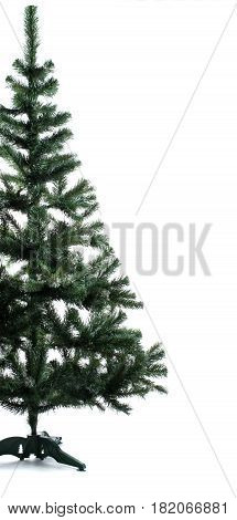 Half of Artificial green Christmas Tree over white background