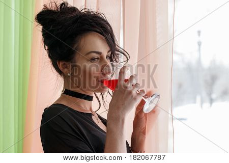 Girl With Black Hair In Black Clothes Near The Window
