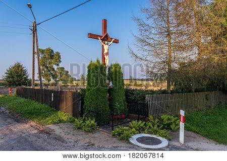 Wayside cross in small village of Pomorskie Region in Poland