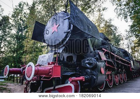 Old steam locomotive with Soviet star in regional promotion park in Szymbark Poland