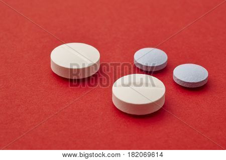 Pills over a red background. Medicament treatment. Health care photo