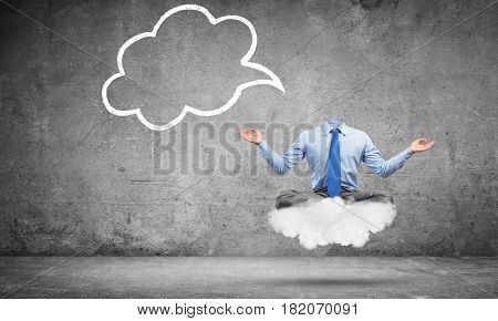 Businessman in lotus pose without head meditating on cloud