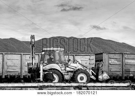 Coal transshipment of railway wagons  in the coal shipping terminal.