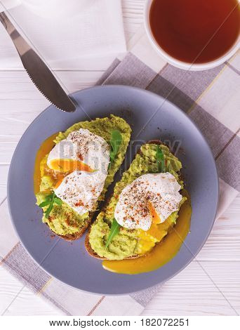 Toast With Poached Egg, Puree Avocado, Spices And Arugula