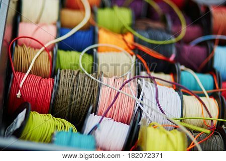 Spools With Rope Of Different Colors For Sewing Or Crafting On A Market