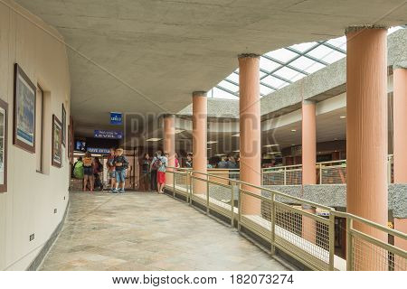CANGO CAVES SOUTH AFRICA - MARCH 24 2017: Unidentified tourists in the building at the Cango Caves near Oudtshoorn in the Western Cape Province