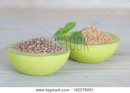 Healthy Chia seeds in green bowls. Grained and grinded chia seed.