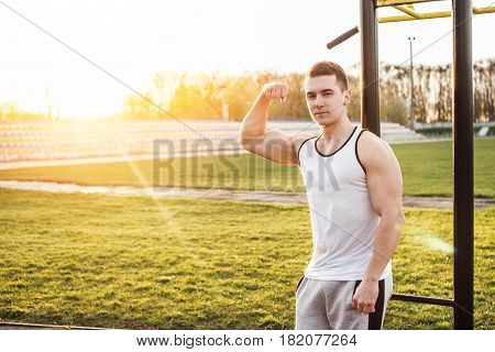 Man Stand At Stadium Background And Smile
