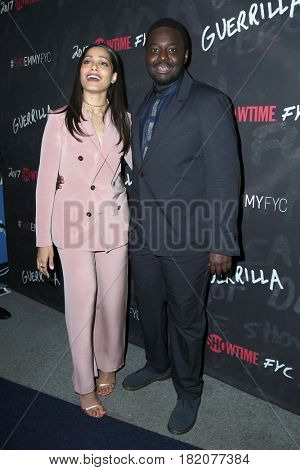 LOS ANGELES - APR 13:  Freida Pinto, Babou Ceesay at the