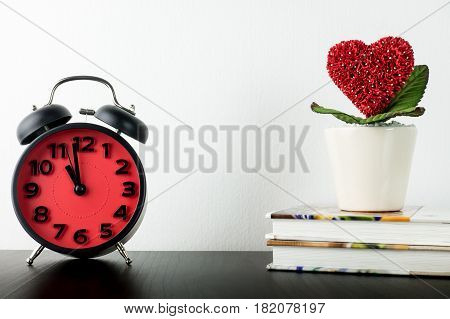 Clock is counting for love heart valentines concept