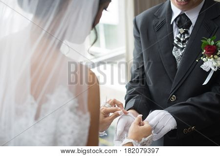 bride undressing white gloves groom morning preparation on her wedding