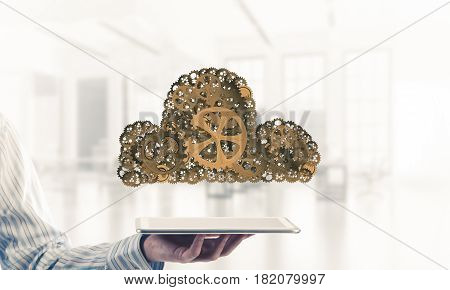 Close of businessman presenting tablet pc and cloud computing concept. Mixed media