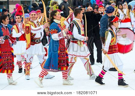 Razlog, Bulgaria - January 14, 2017: People dancing in balkan traditional clothing at the festival