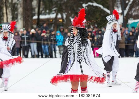 Razlog, Bulgaria - January 14, 2017: Ladies in bright red and white costumes dancing at the festival