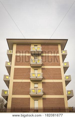 Particular design of a condominium building with sky background