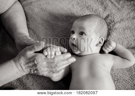 grandmother holds the hand of his beloved grandson