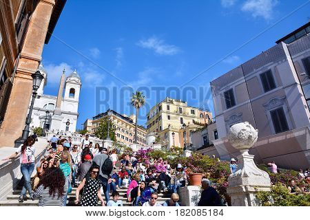 ROME ITALY - APRIL 13 2017: Spanish Steps and Square of Spain (Piazza di Spagna) popular meeting places in Rome Italy on April 13 2017
