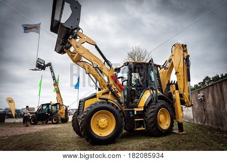 RIGA, LATVIA - APRIL 2017: Cat tractors and other construction equipment at the public event of Riga Machinery Sales.