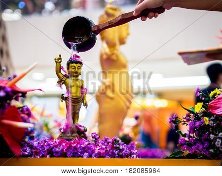 Siddhartha Gautama Buddha Sculpture Flushed by Water and Flower