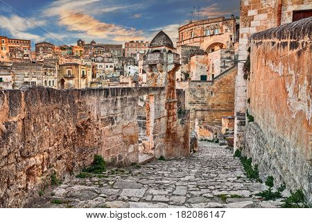 Matera, Basilicata, Italy: picturesque view at sunrise of an ancient alley in the old town