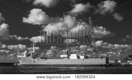 Freighter on the Caribbean sea moor in the port of George Town,Cayman Islands (B&W)