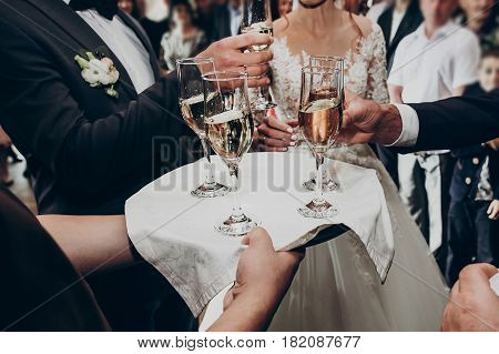 Glasses Of Champagne On Tray, Hands Holding Glasses And Toasting, Celebrating Wedding. Stylish Happy