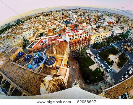 Valencia, Spain. Aerial view of Valencia, Spain in the evening. Plaza de la Reina with many cafes and restaurants, very popular among tourists. Cloudy colorful sky