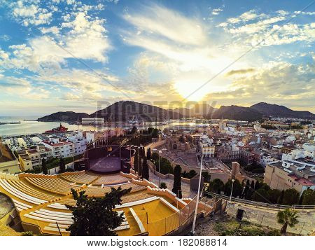 Cartagena, Spain. Aerial view of port city Cartagena in Spain with famous roman amphitheater. Beautiful sunset over the mountains.