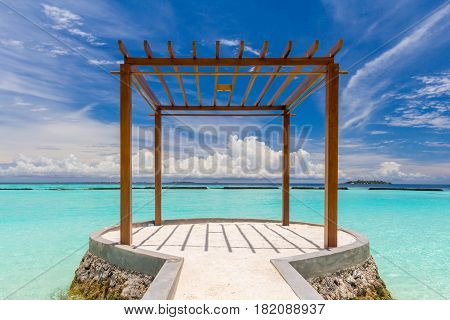 Wooden pavilion at Maldives in front of Indian ocean