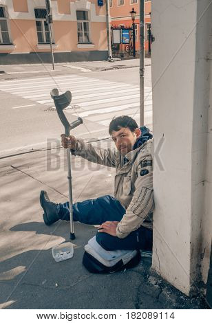 MOSCOW RUSSIAN FEDERATION - APRIL 22: Disabled begging in the city and asks for alms. April 22 2016 Novokuznetskaya street Moscow Russia