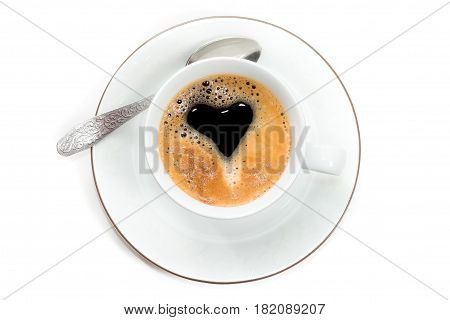 Top view to cup of fresh brewed espresso with creama in form of heart