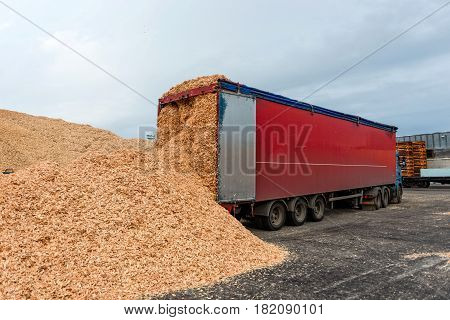 Maritime transportation industry. Truck warehouse place landed in sawdust loads.