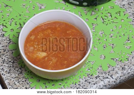 Preparation Of Tomato Soup. The Soup Poured Into The Cup Cools On The Table.
