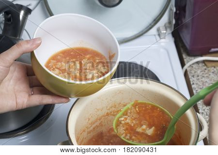 Preparation Of Tomato Soup. The Woman Pours The Soup Over The Cups.
