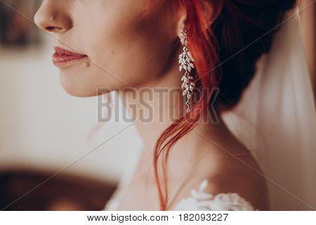 Stylish Bride Detail, Luxury Earring And Red Hair Curl, Beautiful Wedding Dress. Rustic Wedding Morn