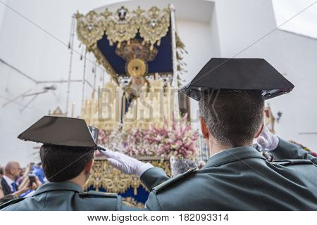 Linares SPAIN - April 16: Soldiers of the Spanish civil guard salute when the national anthem at the exit of the Virgin of beautiful love during Holy week in Linares Andalusia Spain