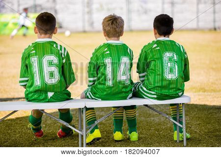 Kids Soccer Team. Young Boys Reserve Players Sitting on Benhttps://www.bigstockphoto.com/pl/account/uploads/contribute?edit=182094007#categoriesch and Watching Youth Soccer Match. School Football Soccer Game