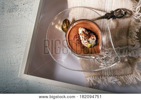 Glass with Chocolate Mousse Dessert served on a wooden surface
