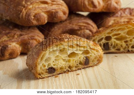 Fresh French chocolate croissants close up