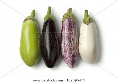 Fresh variety of raw eggplants in a row
