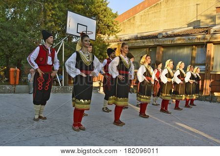 Ivanovo Serbia August 15 2016. The group of young people dancing traditional folk dances from the region of Serbia.