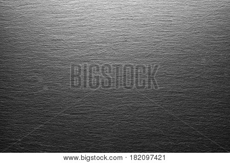 Empty black slate board with stone texture