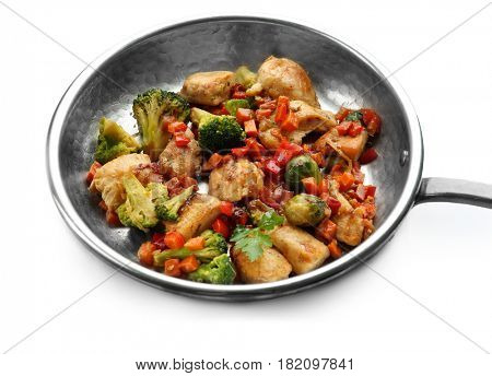 Chicken stir fry with vegetables in pan on white background