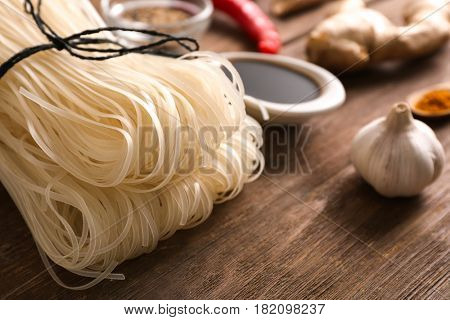 Rice noodles on wooden table