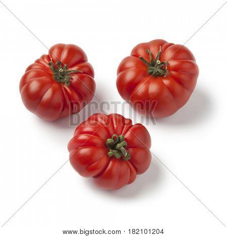 Fresh red ripe merinda tomatoes on white background