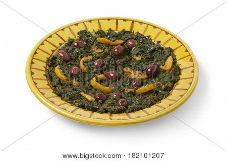 Traditional Moroccan dish with spinach, olives and preserved lemon on white background