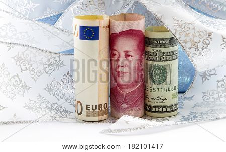 Euro currency of yuan euro and dollar reflections positive success of global networking and policy integration. Money placed with white and blue ribbon and paper.