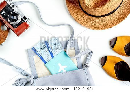 vacation concept with traveller outfit passport, tickets and camera on white desk background top view