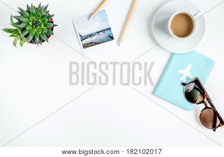 traveller set with cup of coffee and camera in vacation design on white table background top view mock up